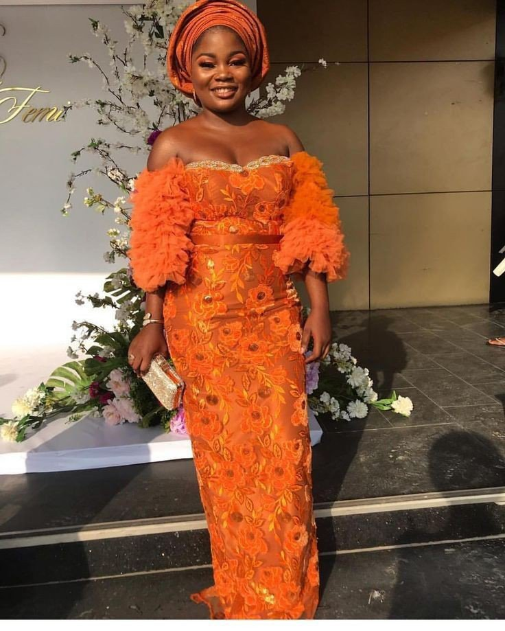 Orange lace gown with net sleeeve