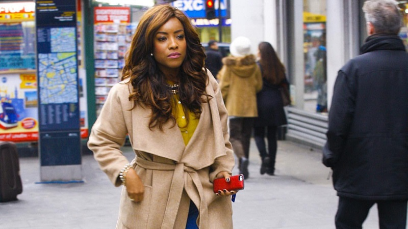Joselyn Dumas Walks The Street Of London In A Nude Coat And Denim Pants
