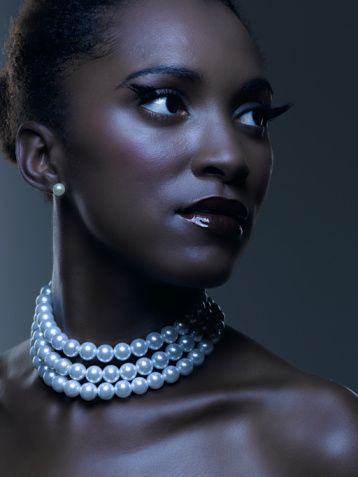 beautiful woman wearing pearl bead necklace