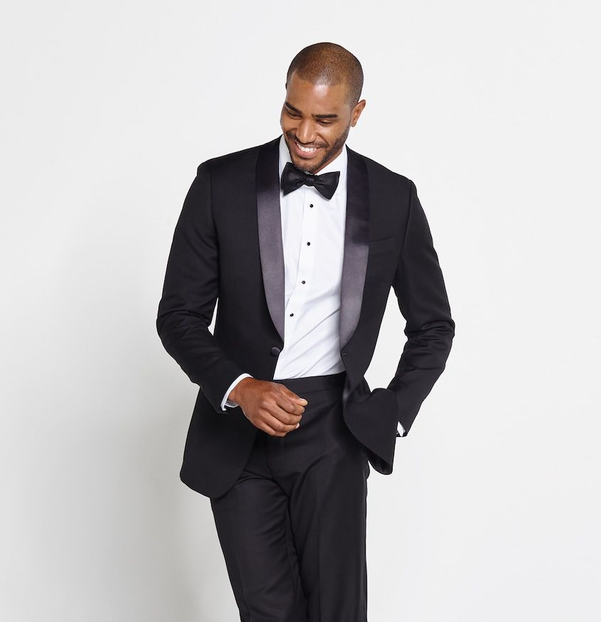 black shawl lapel tuxedo on a smiling African man