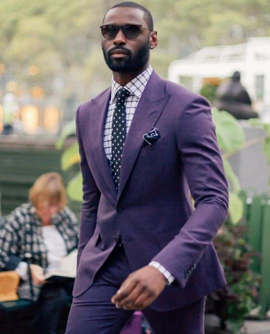 man in a peak lapel suit and glasses