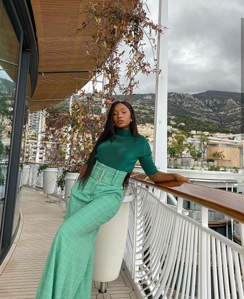 lady in a green analogous mix outfit