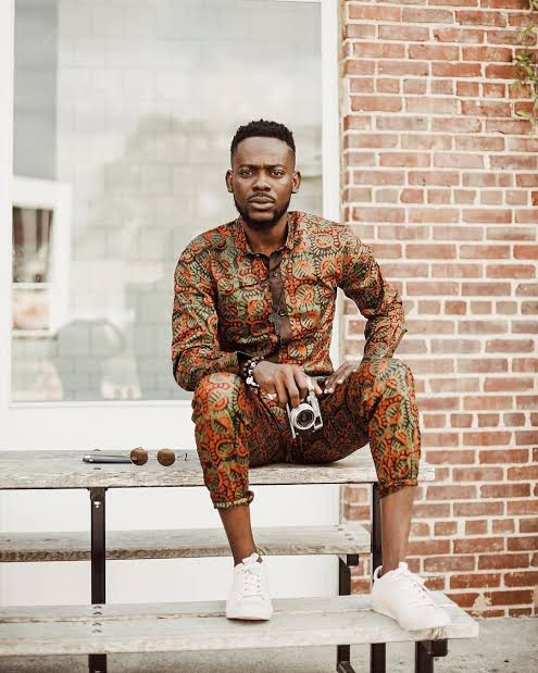 Adegule Gold in an up and down ankara outfit with white sneakers