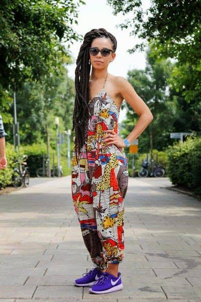 lady wearing ankara jumpsuit with blue sneakers
