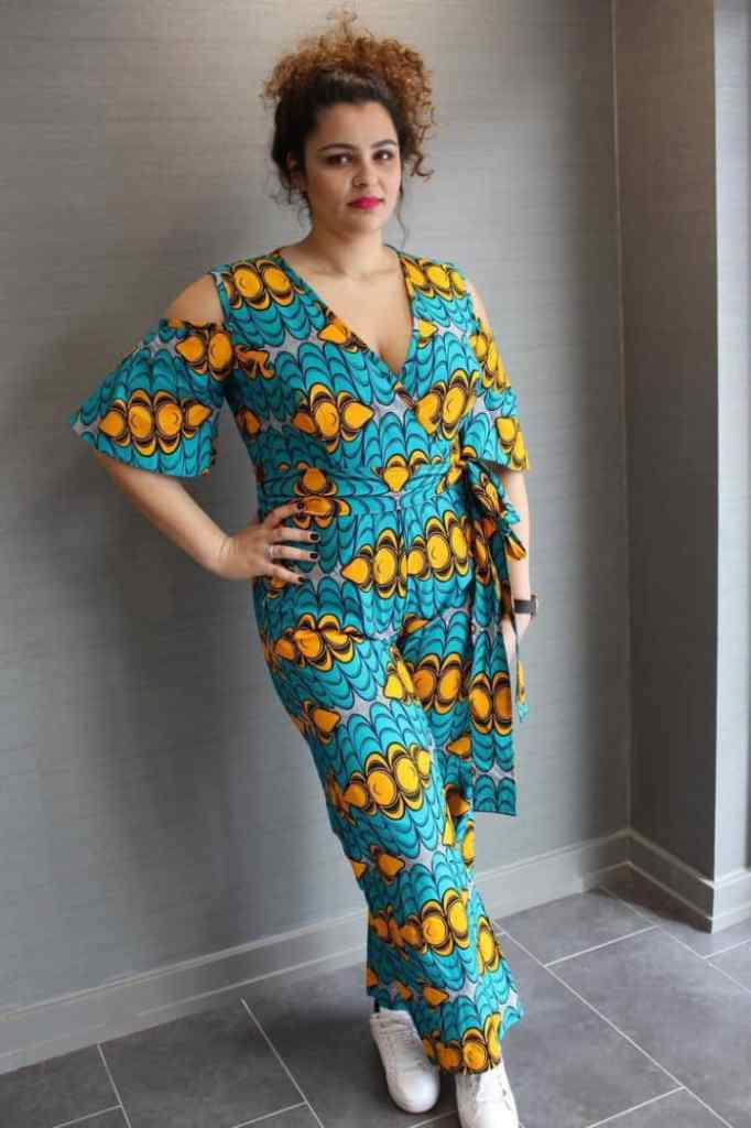 lady on ankara jumpsuit and sneakers