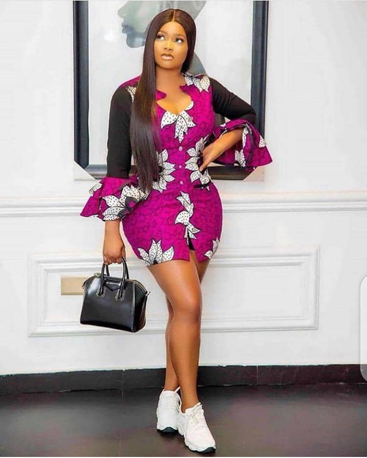 lady in short ankara gown with white sneakers