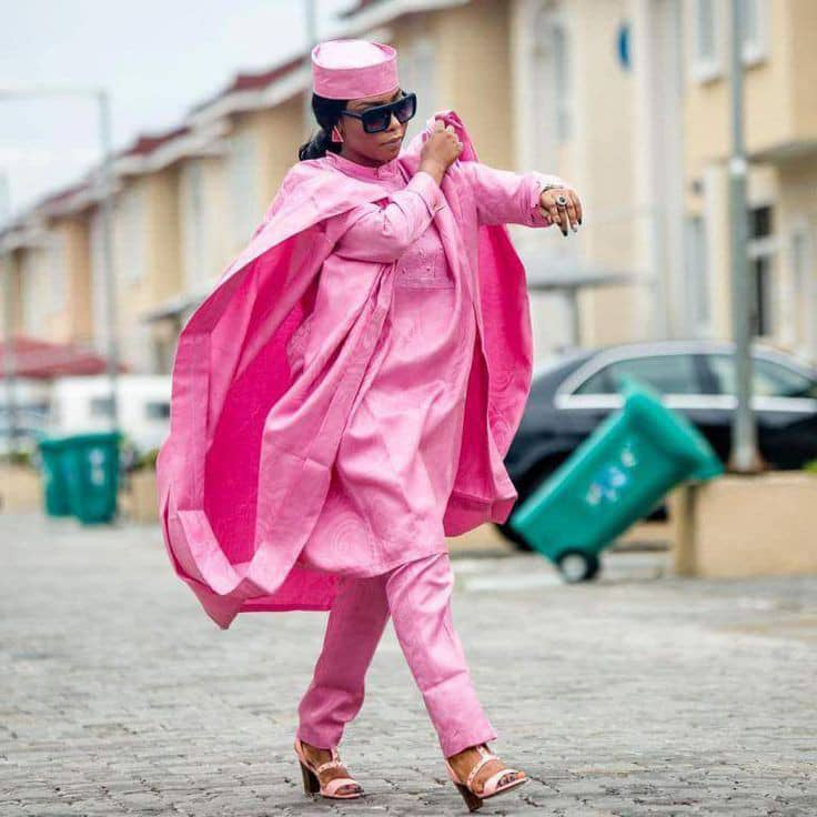 lady rocking pink agbada outfit