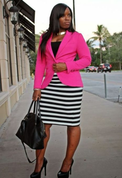 lady in pink blazer and white/black stripped skirt, ready for a job interview