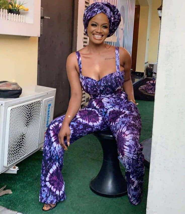 lady in a blue adire jumpsuit