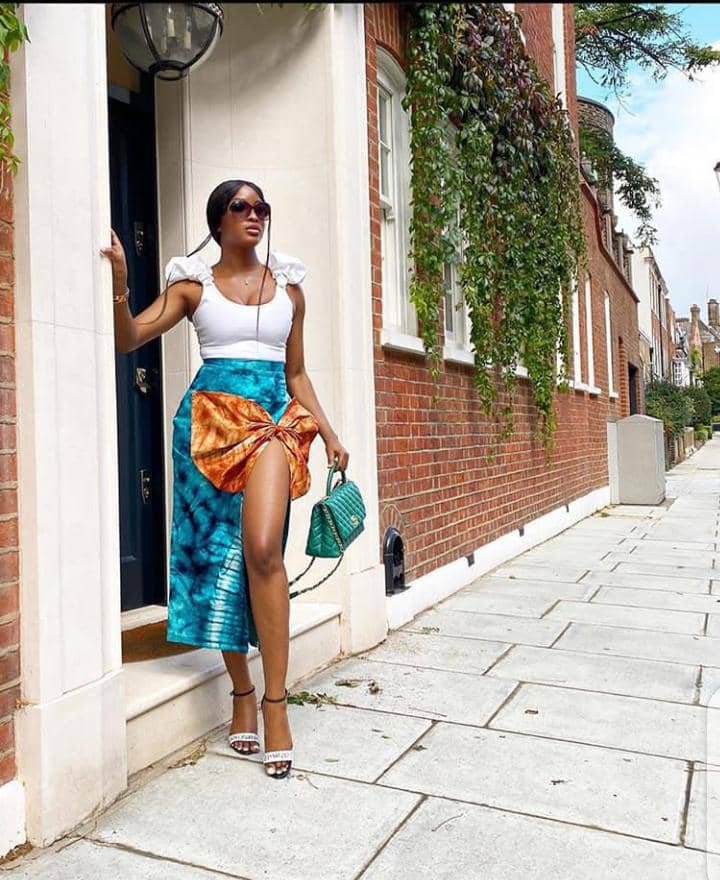 lady in an adire midi skirt