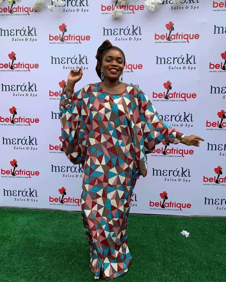 lady rocking ankara long gown at an event