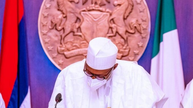 President Buhari signs 2021 budget into law (photos)