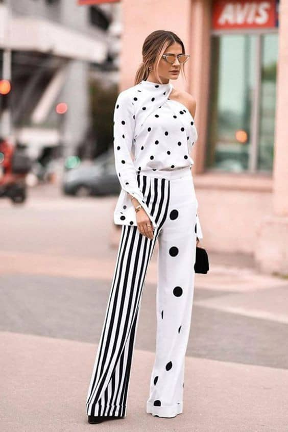 lady wearing white polka dots shirt with palazzo pants