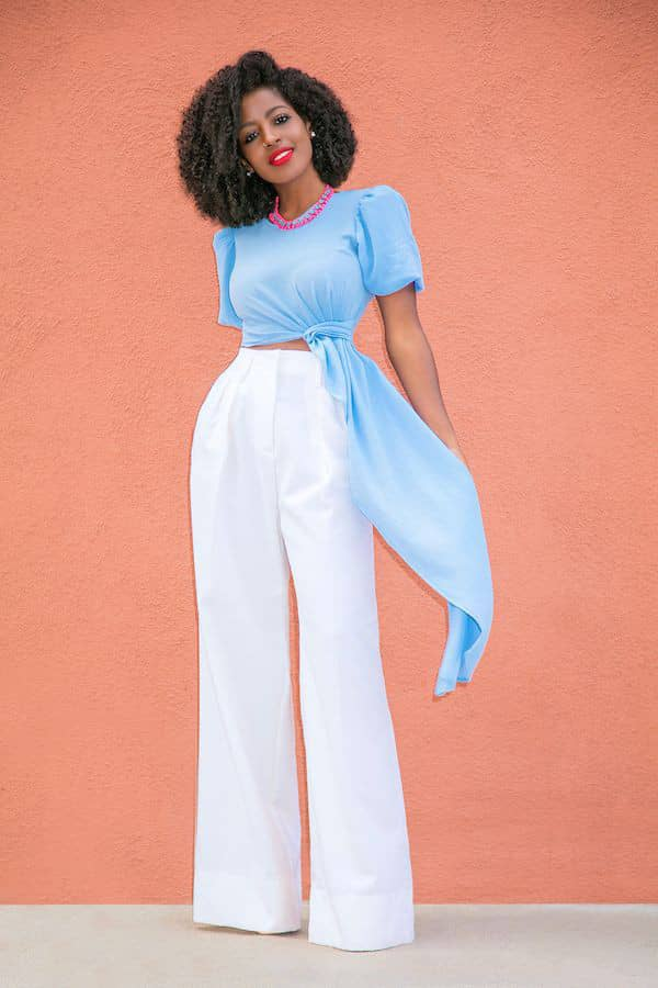 lady rocking blue top with white palazzo