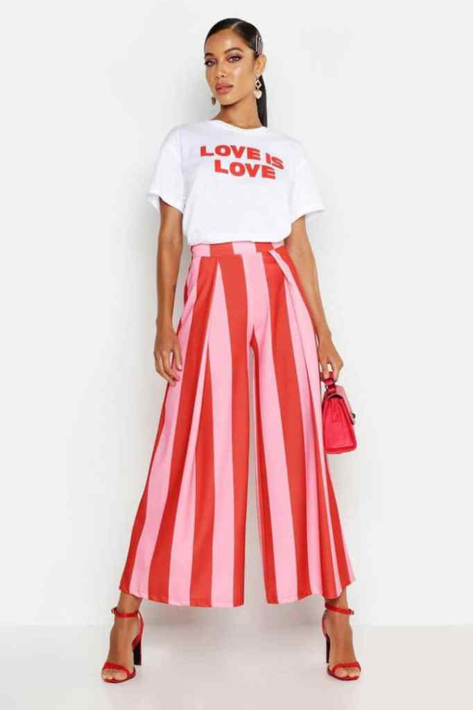 lady wearing white T with red and white stripped palazzo