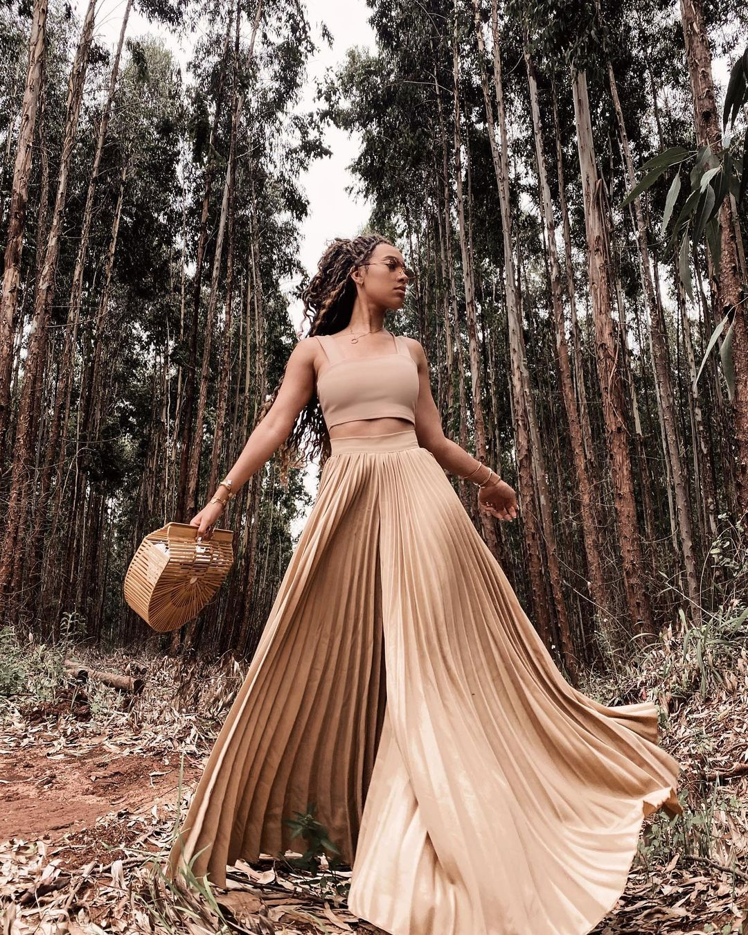 Sarah Langa Struts With Glam In Flare Skirt