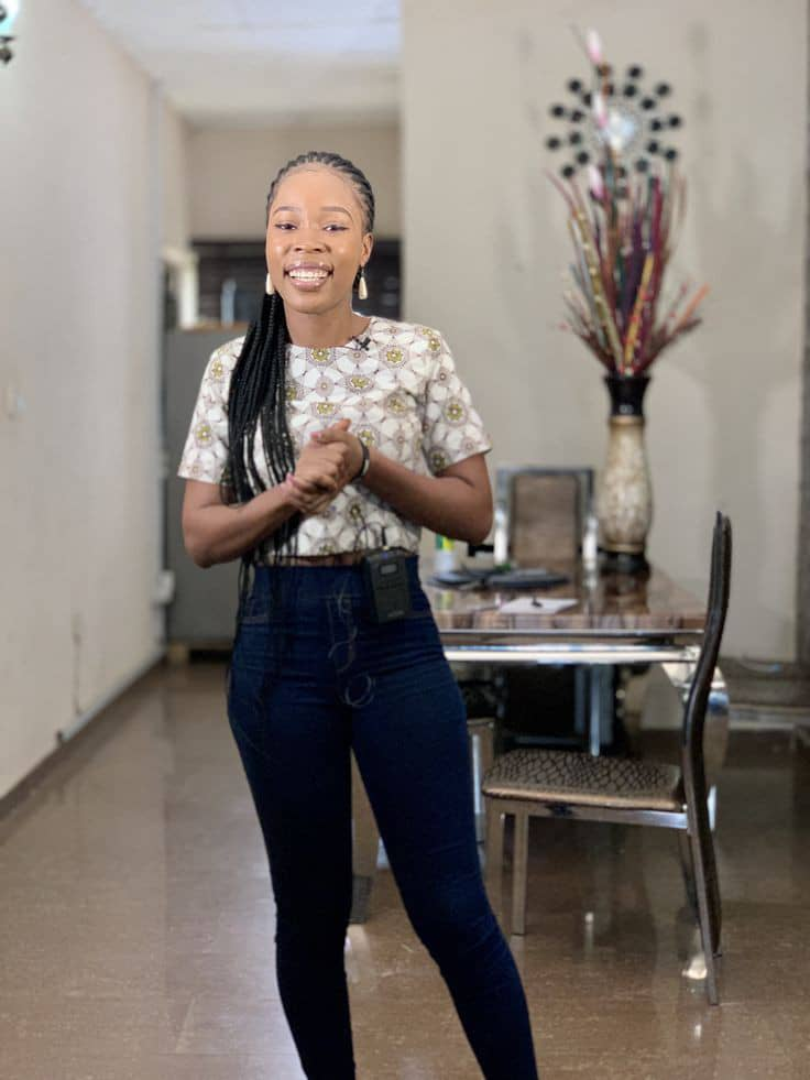 smiling lady wearing top and jeans