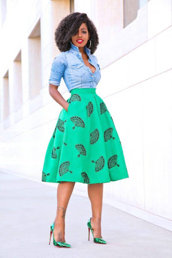 lady wearing jeans shirt with ankara flare skirt