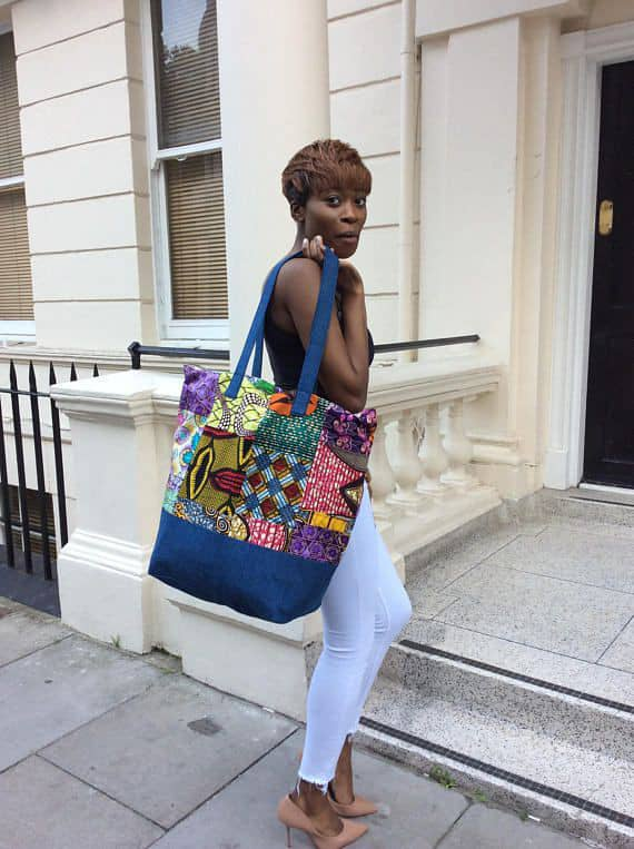 lady carrying a big ankara and jeans combination bag