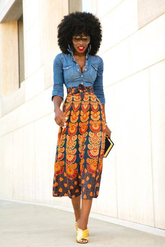 lady wearing and walking in jeans shirt and ankara skirt