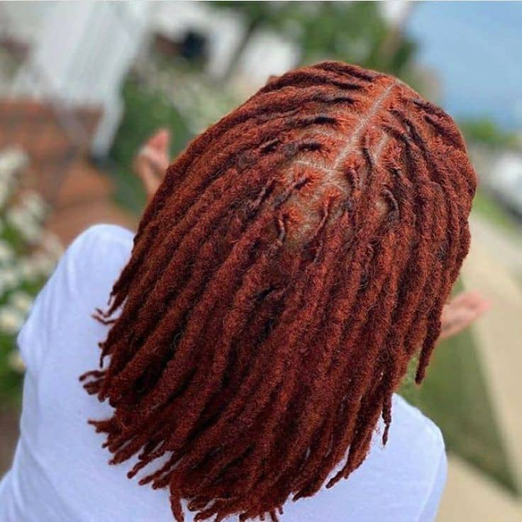 Lady just finished dyeing her dreadlocks red