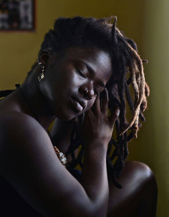 Lady with nose ring showing how to achieve dreadlocks