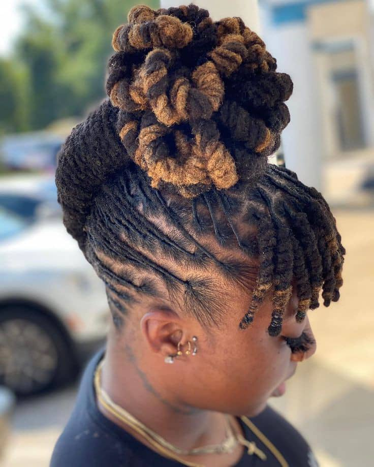 lady styling her dreads on top of her head