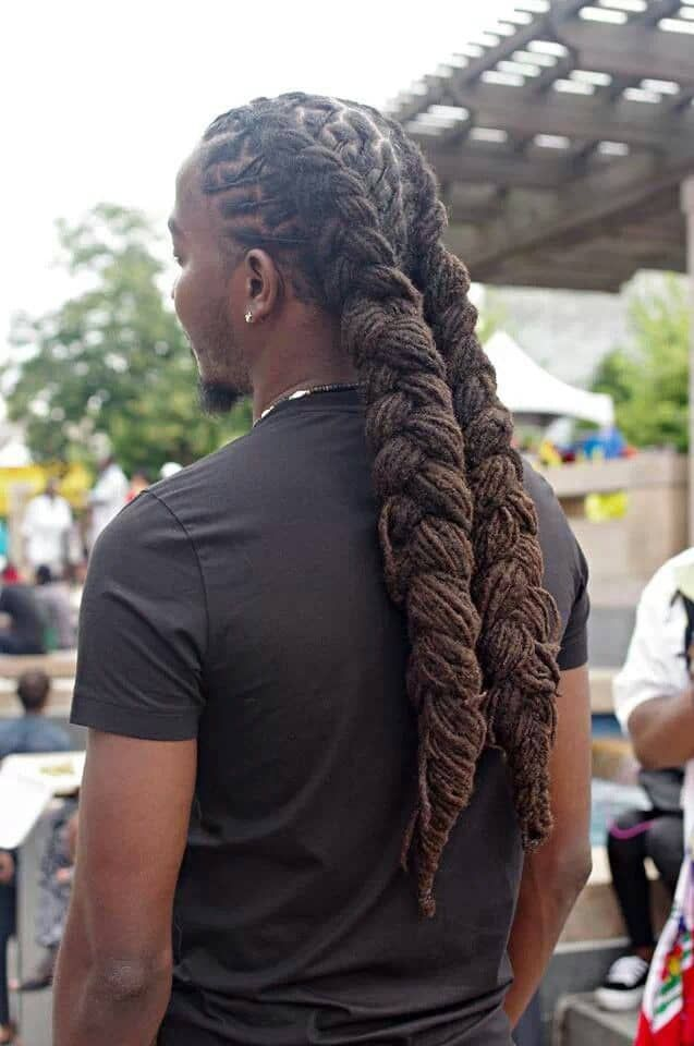 man wearing dreadlocks with double ponytails